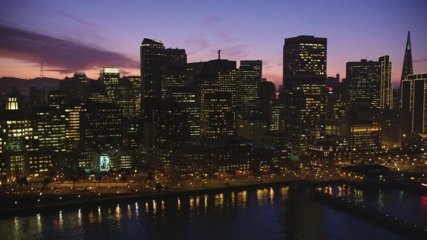 5K Aerial Video Flyby downtown and reveal the Ferry Building, San Francisco, California, twilight Aerial Stock Footage | DCSF10_063