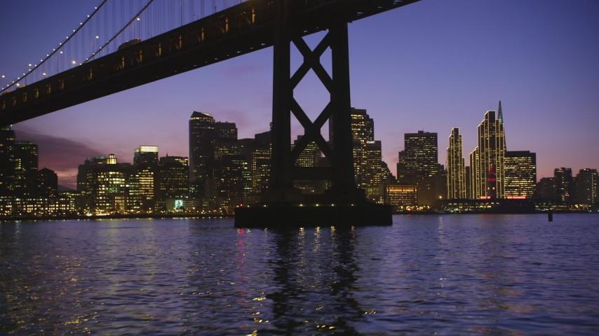 5K Aerial Video Fly under Bay Bridge near Downtown San Francisco, California, twilight Aerial Stock Footage | DCSF10_066