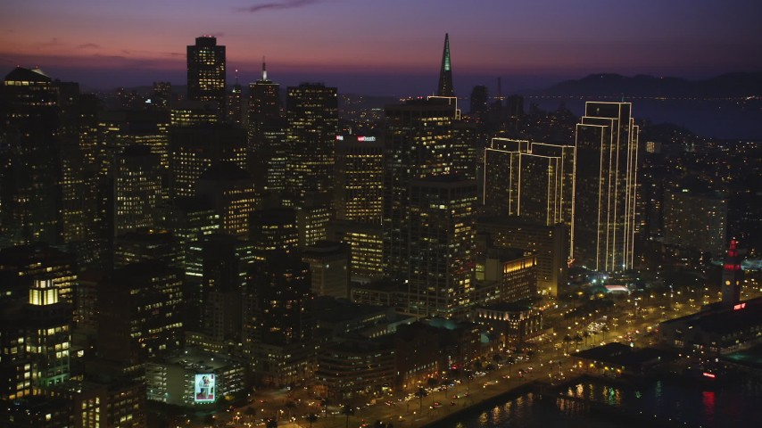 5K Aerial Video Flyby the downtown skyline, and reveal part of the Bay Bridge, San Francisco, California, night Aerial Stock Footage | DCSF10_070