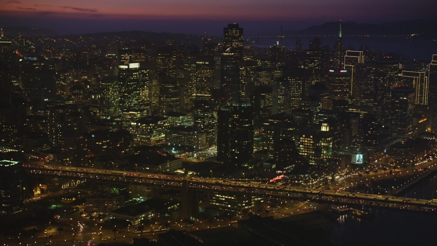5K Aerial Video Flyby heavy traffic on the Bay Bridge by Downtown San Francisco, California, night Aerial Stock Footage   DCSF10_071