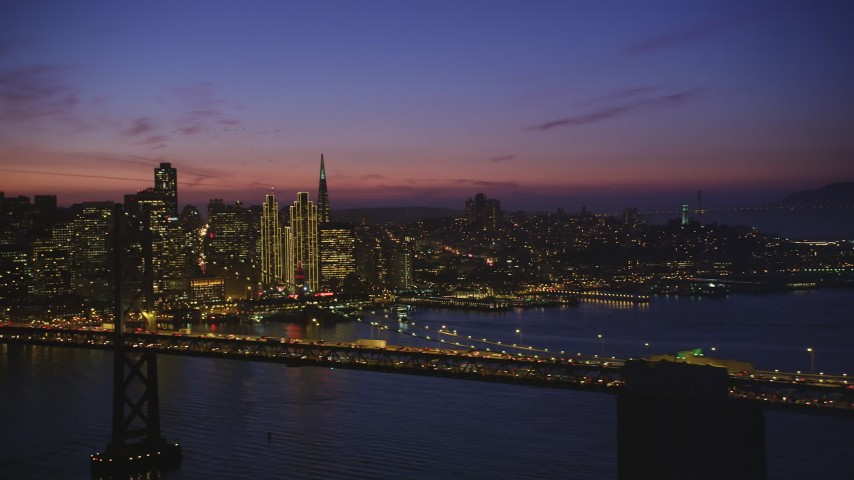 5K Aerial Video Flying by the Bay Bridge with San Francisco skyline in the background, California, night Aerial Stock Footage | DCSF10_072