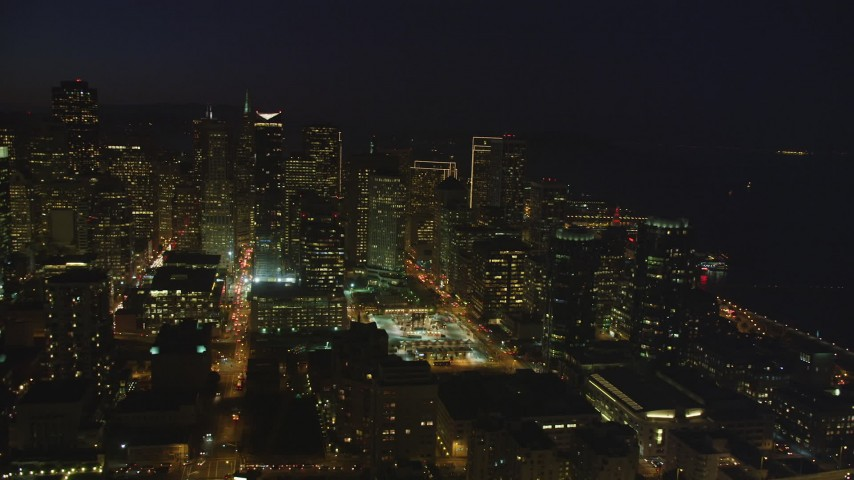 5K Aerial Video Heavy traffic on streets through downtown, reveal One Rincon Hill skyscraper, San Francisco, California, night Aerial Stock Footage | DCSF10_075