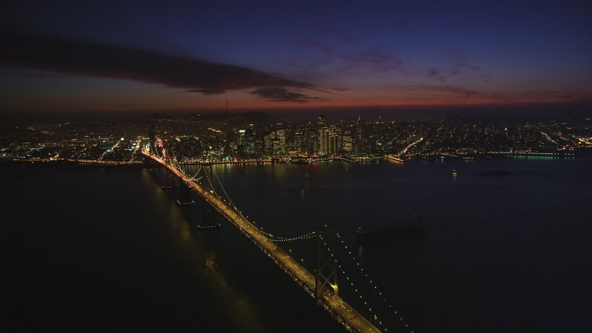 5K Aerial Video of A view of the Bay Bridge and Downtown San Francisco, California, night Aerial Stock Footage DCSF10_078 | Axiom Images