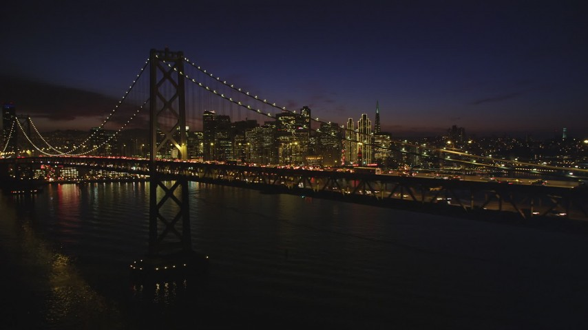 5K Aerial Video of The Bay Bridge and Downtown San Francisco skyline, California, night Aerial Stock Footage | DCSF10_080
