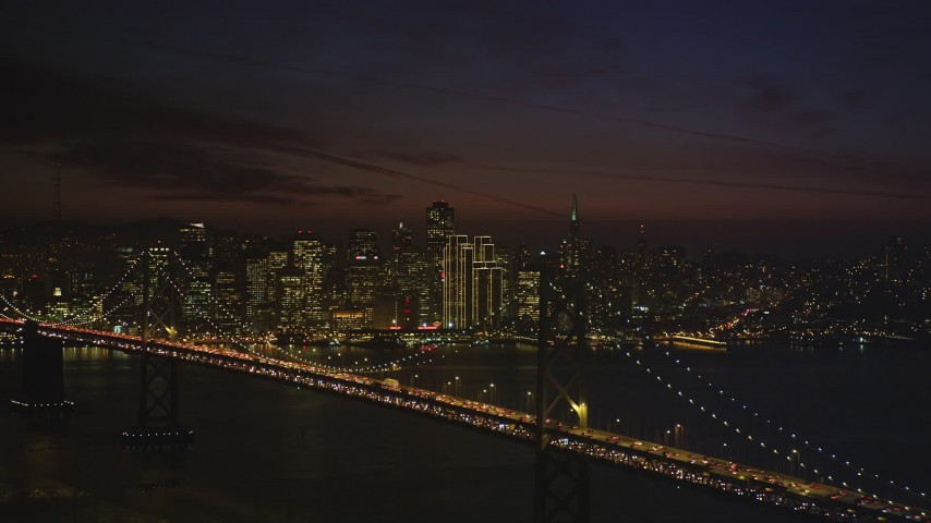 5K Aerial Video Bay Bridge and Downtown San Francisco skyline, seen from Yerba Buena Island, California, night Aerial Stock Footage | DCSF10_085