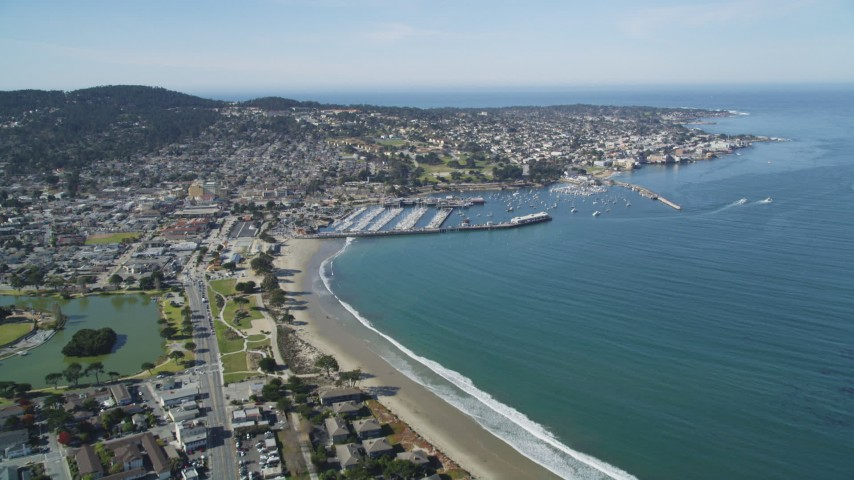 5K Aerial Video Tilt from US Naval Postgraduate School to reveal Monterey State Beach and Monterey, California Aerial Stock Footage | DCSF11_001