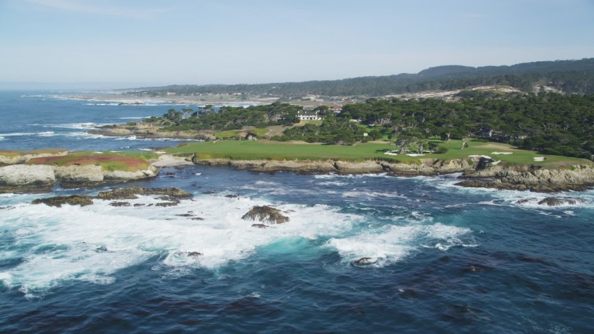 5K Aerial Video Ocean waves rolling toward Cypress Point Golf Course, Pebble Beach, California Aerial Stock Footage | DCSF11_006