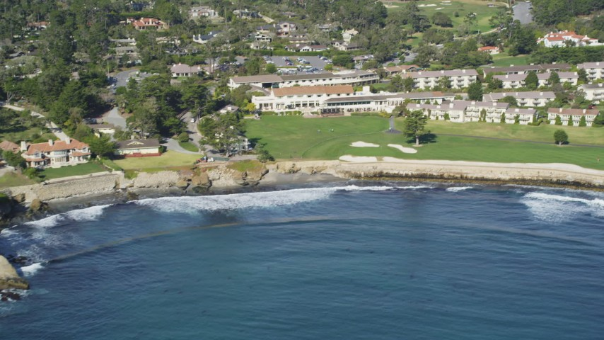 5K Aerial Video Tilt from the ocean to reveal Pebble Beach Golf Links and Pebble Beach Resorts, California Aerial Stock Footage | DCSF11_007
