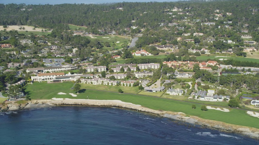 5K Aerial Video Reverse view of Pebble Beach Golf Links and Pebble Beach Resorts, California Aerial Stock Footage | DCSF11_008