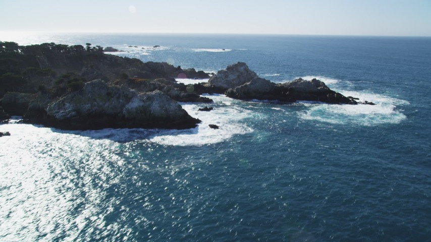 5K Aerial Video Tilt to reveal waves crashing into coastal rock formations, Carmel, California Aerial Stock Footage | DCSF11_013