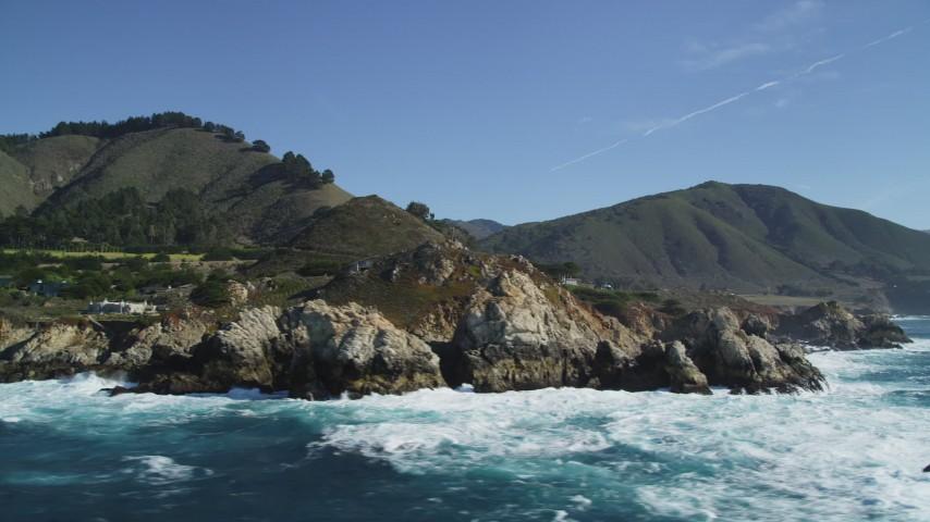 5K Aerial Video Waves crashing into coastal rock formations, upscale homes, Carmel, California Aerial Stock Footage | DCSF11_020