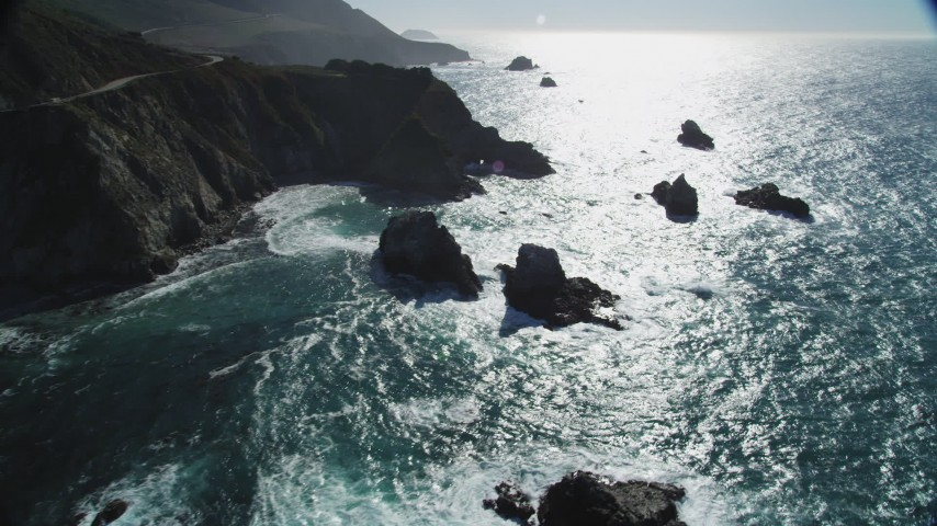 5K Aerial Video Approach waves rolling toward coastal rock formations, Big Sur, California Aerial Stock Footage | DCSF11_021