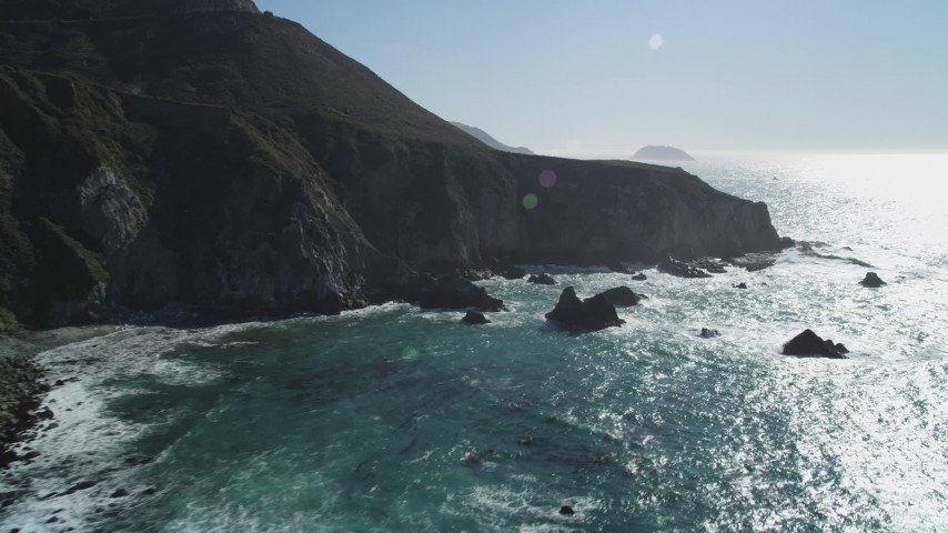 5K Aerial Video Flying by waves crashing into the base of coastal cliffs, Big Sur, California Aerial Stock Footage | DCSF11_023