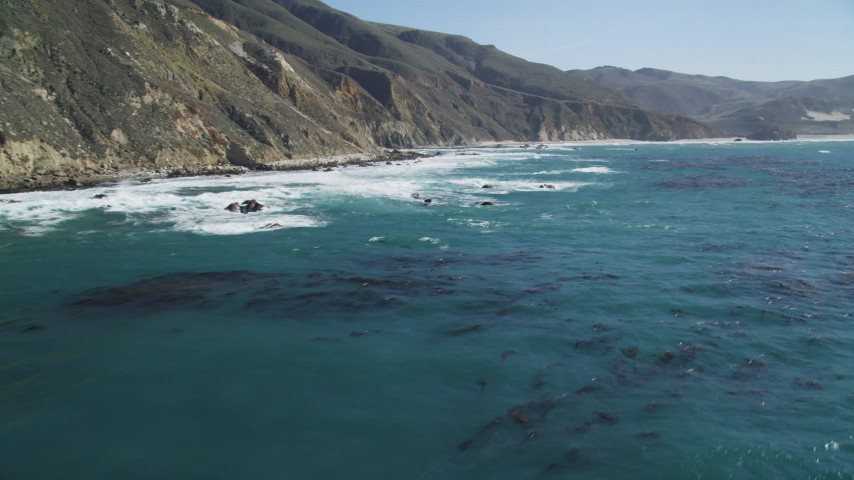 5K Aerial Video Fly over kelp near coastal cliffs, Big Sur, California Aerial Stock Footage | DCSF11_026