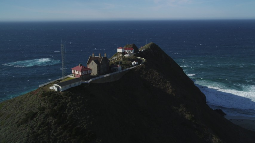 5K Aerial Video Flying by Point Sur Lighthouse buildings atop a coastal cliff, Big Sur, California Aerial Stock Footage DCSF11_028 | Axiom Images