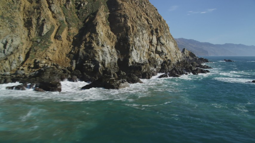 5K Aerial Video Fly low over waves slamming into coastal cliffs, Big Sur, California Aerial Stock Footage | DCSF11_031