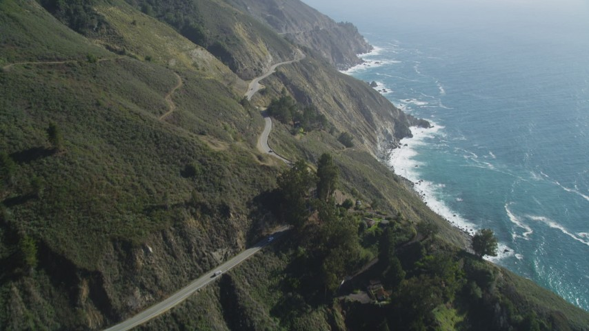 5K Aerial Video Tilt up Highway 1 with light traffic above coastal cliffs, Big Sur, California Aerial Stock Footage | DCSF11_034