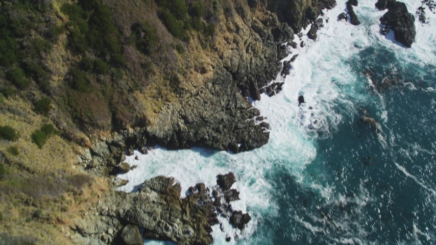 5K Aerial Video Tilt from waves crashing and approach cliffs on the coast, Big Sur, California Aerial Stock Footage | DCSF11_035