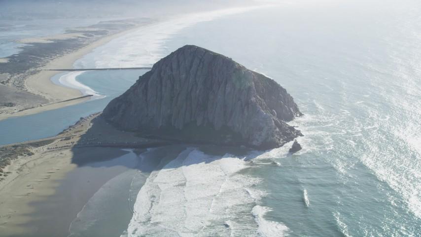 5K Aerial Video Flying by Morro Rock in Morro Bay, California Aerial Stock Footage | DCSF11_045