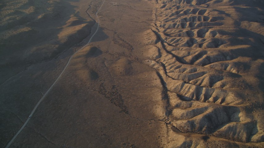 5K Aerial Video Reverse view of a desert road beside San Andreas Fault, San Luis Obispo County, California Aerial Stock Footage | DCSF12_012