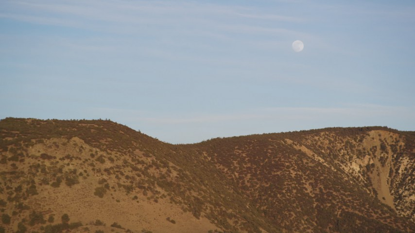 5K Aerial Video Flying by the a ridge in the Temblor Range with the moon overhead, San Luis Obispo County, California Aerial Stock Footage | DCSF12_013