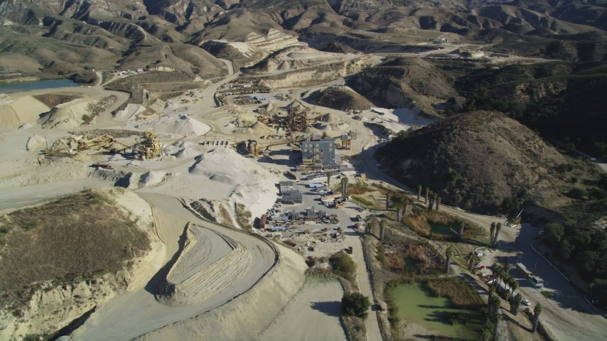 5K stock footage aerial video of orbiting a quarry with industrial equipment, Simi Valley, California Aerial Stock Footage | DFKSF01_001