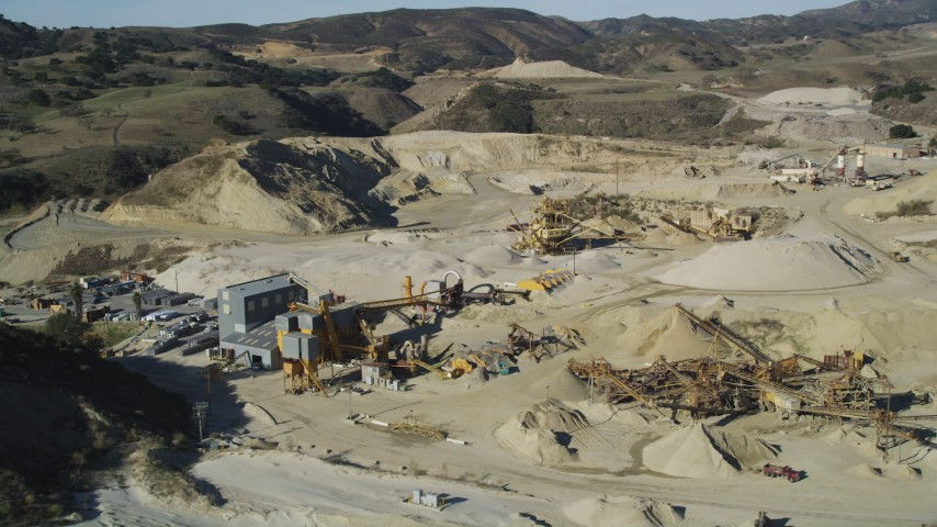 5K stock footage aerial video of flying by a quarry and industrial equipment, Simi Valley, California Aerial Stock Footage | DFKSF01_002