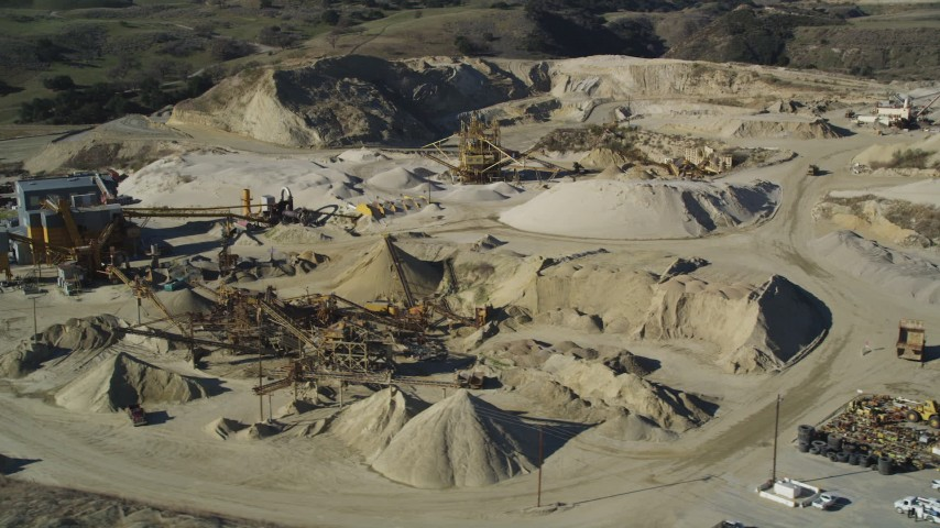 5K stock footage aerial video of flying by industrial equipment at a quarry, Simi Valley, California Aerial Stock Footage | DFKSF01_003