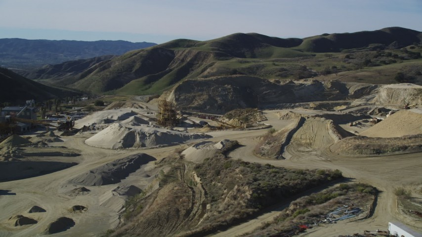 5K stock footage aerial video of flying by a quarry and industrial equipment, Simi Valley, California Aerial Stock Footage | DFKSF01_004