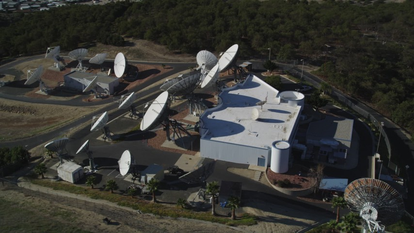 5K stock footage aerial video of orbiting a building with several satellite dishes in the hills, Fillmore, California Aerial Stock Footage | DFKSF01_010