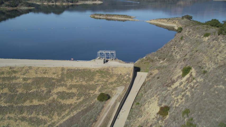 5K stock footage aerial video of following an aqueduct uphill, revealing Casitas Dam, Lake Casitas, California Aerial Stock Footage | DFKSF01_030