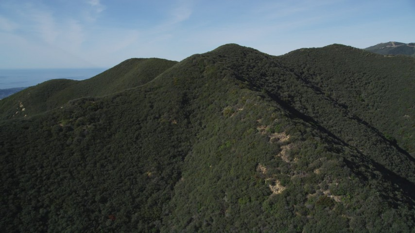 5K stock footage aerial video of approaching the tree covered mountains, Santa Ynez Mountains, California Aerial Stock Footage | DFKSF01_036