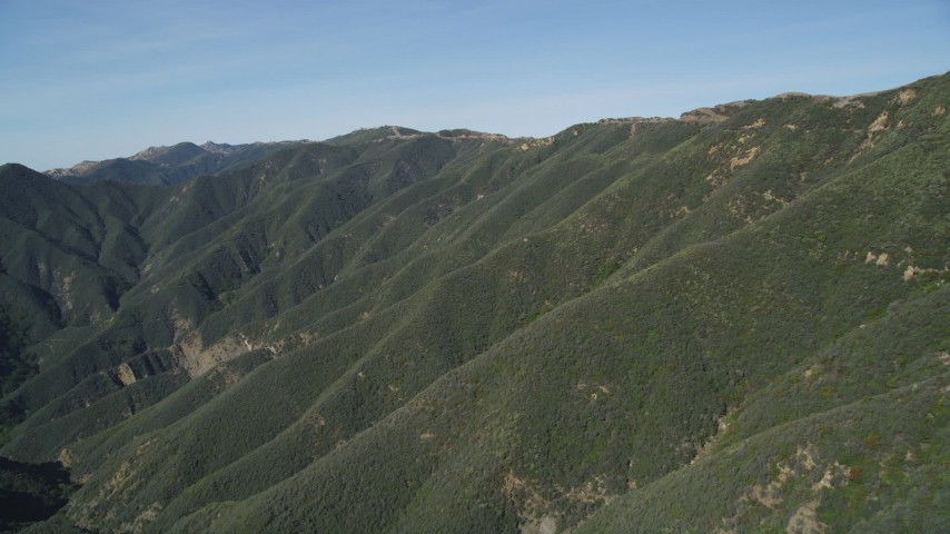 5K stock footage aerial video of approaching mountains, revealing second range, Santa Ynez Mountains, California Aerial Stock Footage | DFKSF01_037
