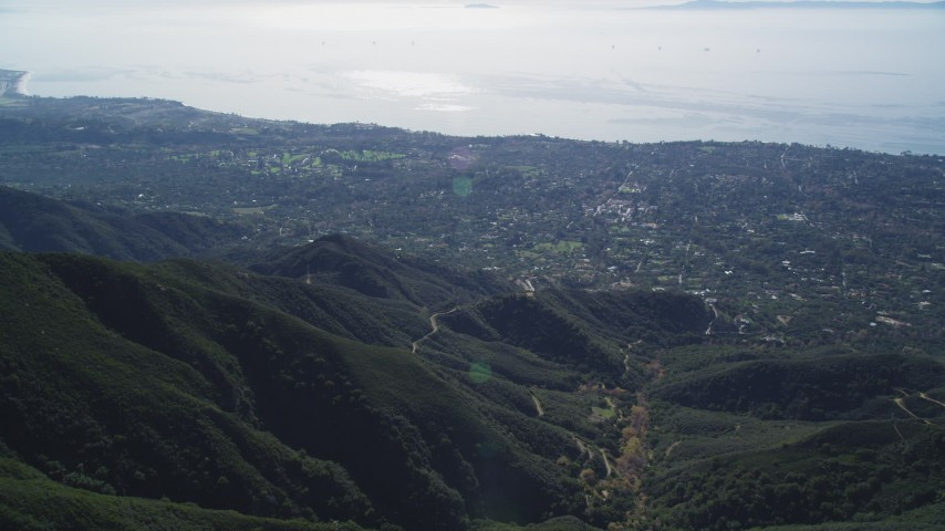 5K stock footage aerial video of flying over a mountain, revealing Santa Barbara, Santa Ynez Mountains, California Aerial Stock Footage | DFKSF01_039