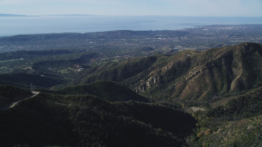 5K stock footage aerial video approach jagged mountainsides, reveal Santa Barbara, Santa Ynez Mountains, California Aerial Stock Footage | DFKSF01_041