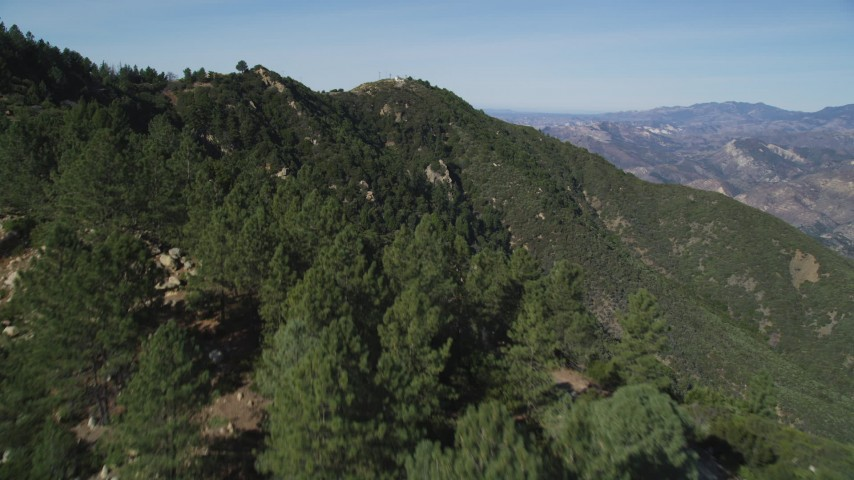 5K stock footage aerial video of flying over tree-lined slopes in the Santa Ynez Mountains, California Aerial Stock Footage | DFKSF01_043