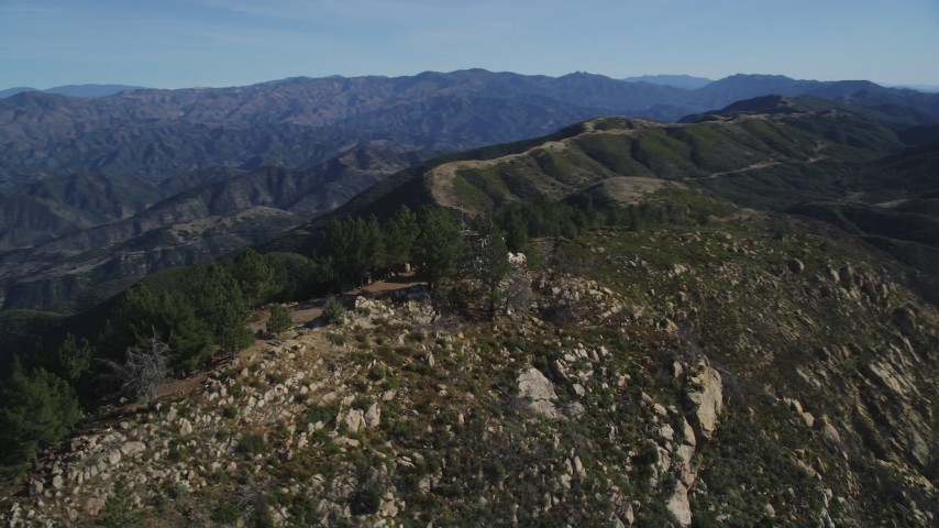 5K stock footage aerial video approach and orbit tree-lined slopes, reveal radio tower, Santa Ynez Mountains, California Aerial Stock Footage | DFKSF01_044