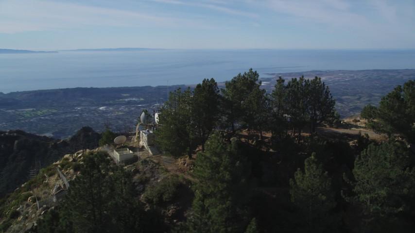 5K stock footage aerial video orbit radio tower on a peak, reveal Santa Barbara, Santa Ynez Mountains, California Aerial Stock Footage | DFKSF01_046