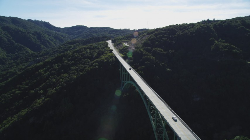 5K stock footage aerial video track black SUV crossing Cold Springs Canyon Arch Bridge, Santa Ynez Mountains, California Aerial Stock Footage DFKSF01_052 | Axiom Images