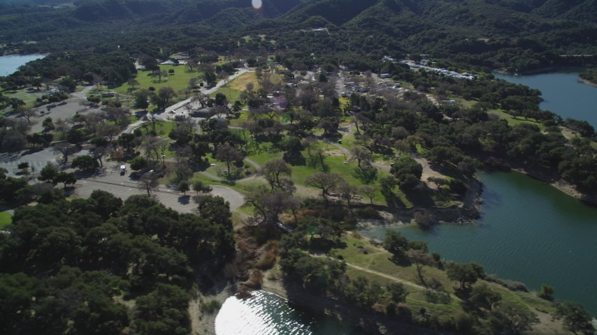 5K stock footage aerial video of flying by a lakeside RV Park at Lake Cachuma, California Aerial Stock Footage | DFKSF01_059