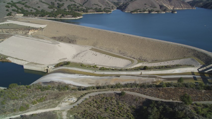 5K stock footage aerial video of flying by Lake Cachuma, revealing Bradbury Dam; Lake Cachuma, California Aerial Stock Footage | DFKSF01_060