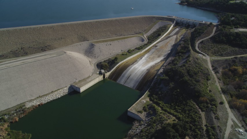 5K stock footage aerial video of flying by Bradbury Dam at Lake Cachuma, California Aerial Stock Footage | DFKSF01_061