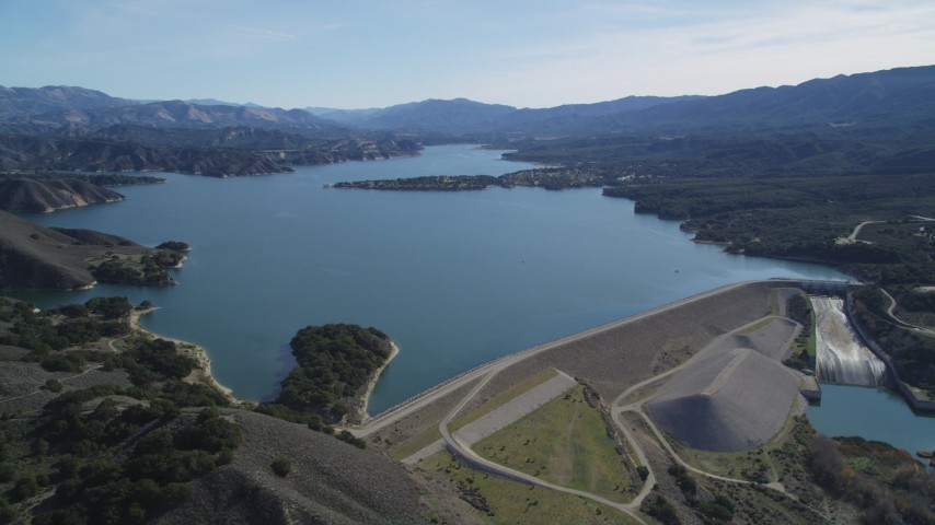 5K stock footage aerial video of flying by the Bradbury Dam, tilt to wider view of Lake Cachuma, California Aerial Stock Footage | DFKSF01_062