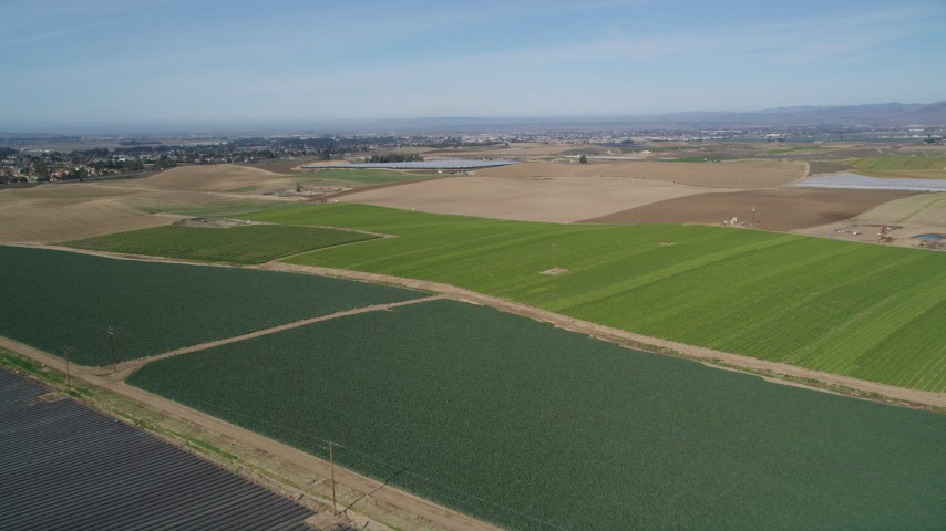 5K stock footage aerial video of flying over crop fields, with wide view of rural landscape in Santa Maria, California Aerial Stock Footage | DFKSF02_001