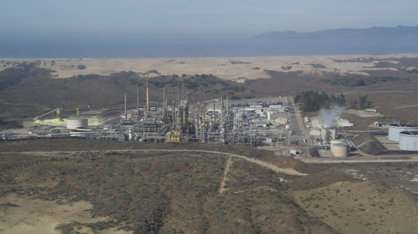 5K stock footage aerial video of approaching Phillips 66 Company Santa Maria Refinery, Arroyo Grande, California Aerial Stock Footage | DFKSF02_017
