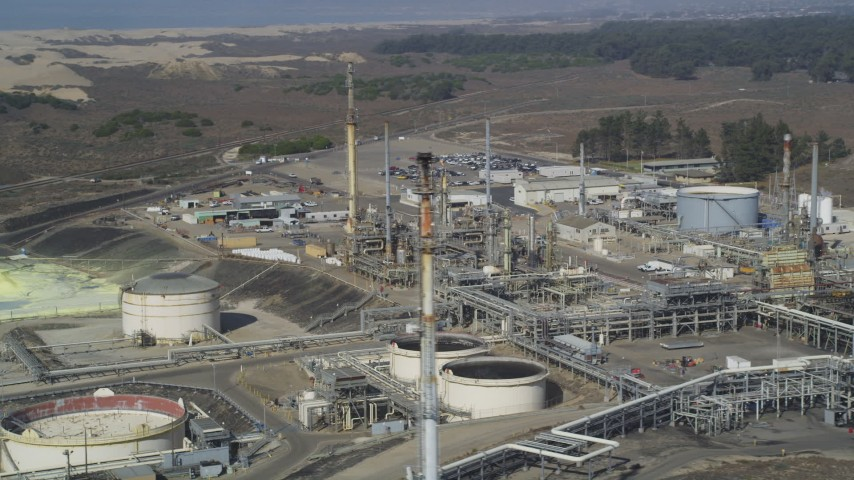 5K stock footage aerial video of flying by the Phillips 66 Company Santa Maria Refinery, Arroyo Grande, California Aerial Stock Footage | DFKSF02_018