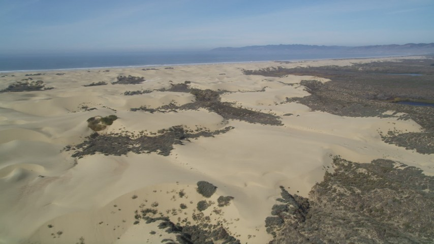 5K stock footage aerial video fly over and pan across sand dunes, Pismo Dunes, California Aerial Stock Footage | DFKSF02_022