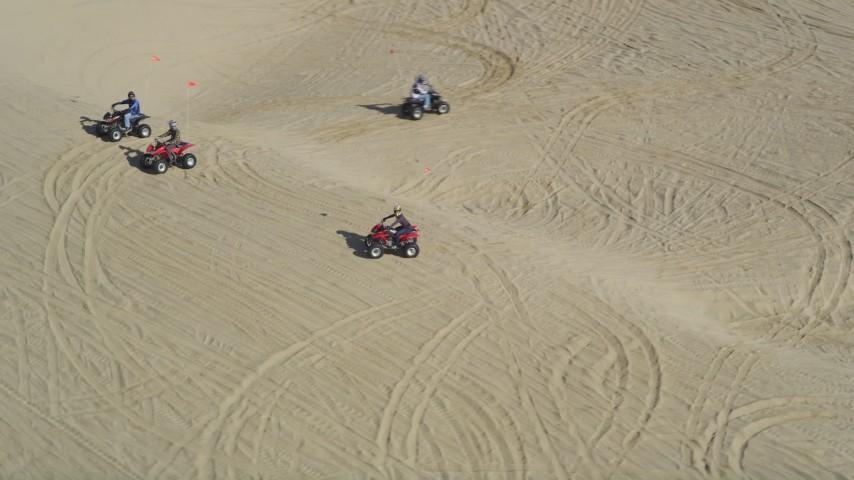 5K stock footage aerial video orbiting ATV riders on the sand dunes, Pismo Dunes, California Aerial Stock Footage | DFKSF02_029