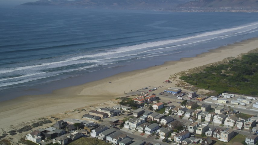5K stock footage aerial video of approaching beachfront homes and Pismo State Beach, Oceano, California Aerial Stock Footage | DFKSF02_032