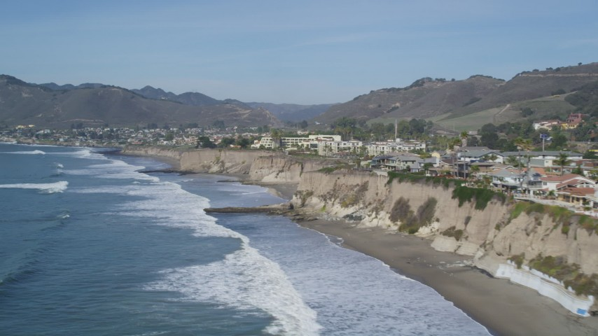 5K stock footage aerial video flyby and pan across oceanfront homes on coastal cliffs, Shell Beach, California Aerial Stock Footage | DFKSF02_044